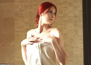 Flaming Redhead Kattie Gold makes a good pose of her shaved constricted love tunnel