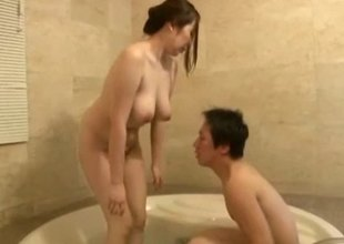 Japanese girl with big, natural titties playing in the bath tub