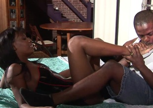 Adorable ebony with natural marangos getting her shaved pussy licked nicely during the time that moaning