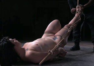 Pale brunette is bound up in Rope Ladder style and drilled with toy