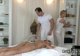 Couple of masseurs fucks hairy blond