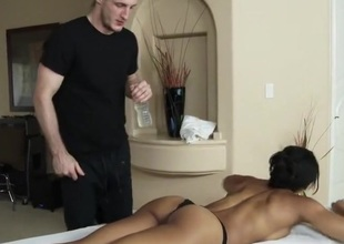 Sophia calls over her masseur to give her a rub down