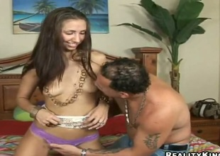 Brunette finds Sergio stylish and takes his hard boner in her mouth