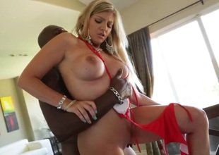 Brianna Brooks is with Lexington Steele and the couple is having interracial sex. The blond is using both her hands to tug a dick. That babe needs them both to handle it.