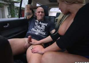 Curvy blonde MILF Olivia Austin with large a-hole and huge tits bounces up and down on a hard cock in the backseat of a car. Bald man drills her soaking wet vagina with his stiffy