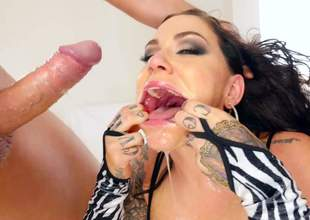 Heavily tattooed whore Karmen Karma loves monster rods and fresh cum. She gives sloppy head to Jonni Darkko and Markus Dupree on camera. Watch her gag on huge rods for fun