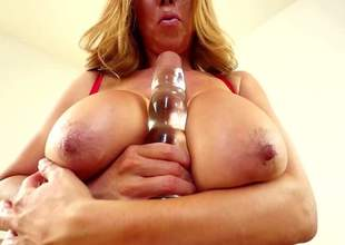 Juicy asian MILF Kianna Dior with huge knockers and thick ass copulates her juggs with big glass dildo. Then busty woman spreads her legs to push it into her moist pink box right in front of the cam