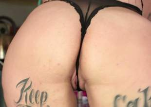 Curvy temptress Brianna Rose with many tattoos all over her sexy body strips without her black lingerie and shows off her priceless ass. Her bubble arse will take your breath away