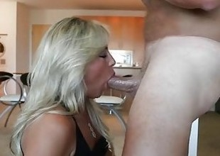 Busty MILF Sucks Cock And Swallows Huge Load