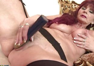 Slutty granny pleasuring herself