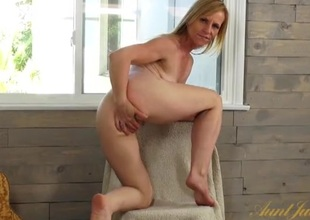 Cute mama has fun fingering her constricted hole