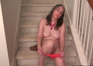 American milf Eva Griffin fingers her nyloned soaked pussy