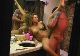 Bathroom counter fuck with a slutty big wobblers milf