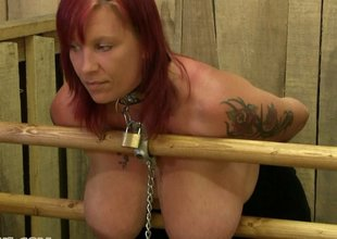 Extreme bondage and milking for redhead sex slave