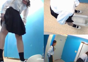 Legal age teenager Asian schoolgirls taking a piss in the toilet